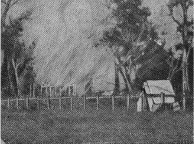 """View of fire in Jones' Hotel after burning for 20 minutes, with tent used by railway line repairers on the right, taken on day of """"Siege of Glenrowan."""""""