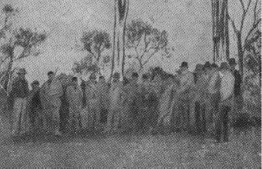 """Group of police and civilians taken immediately after the burning of Jones' Hotel at the """"Siege of Glenrowan."""""""